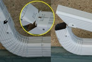 Photo of Gutter Hinges on White Downspout